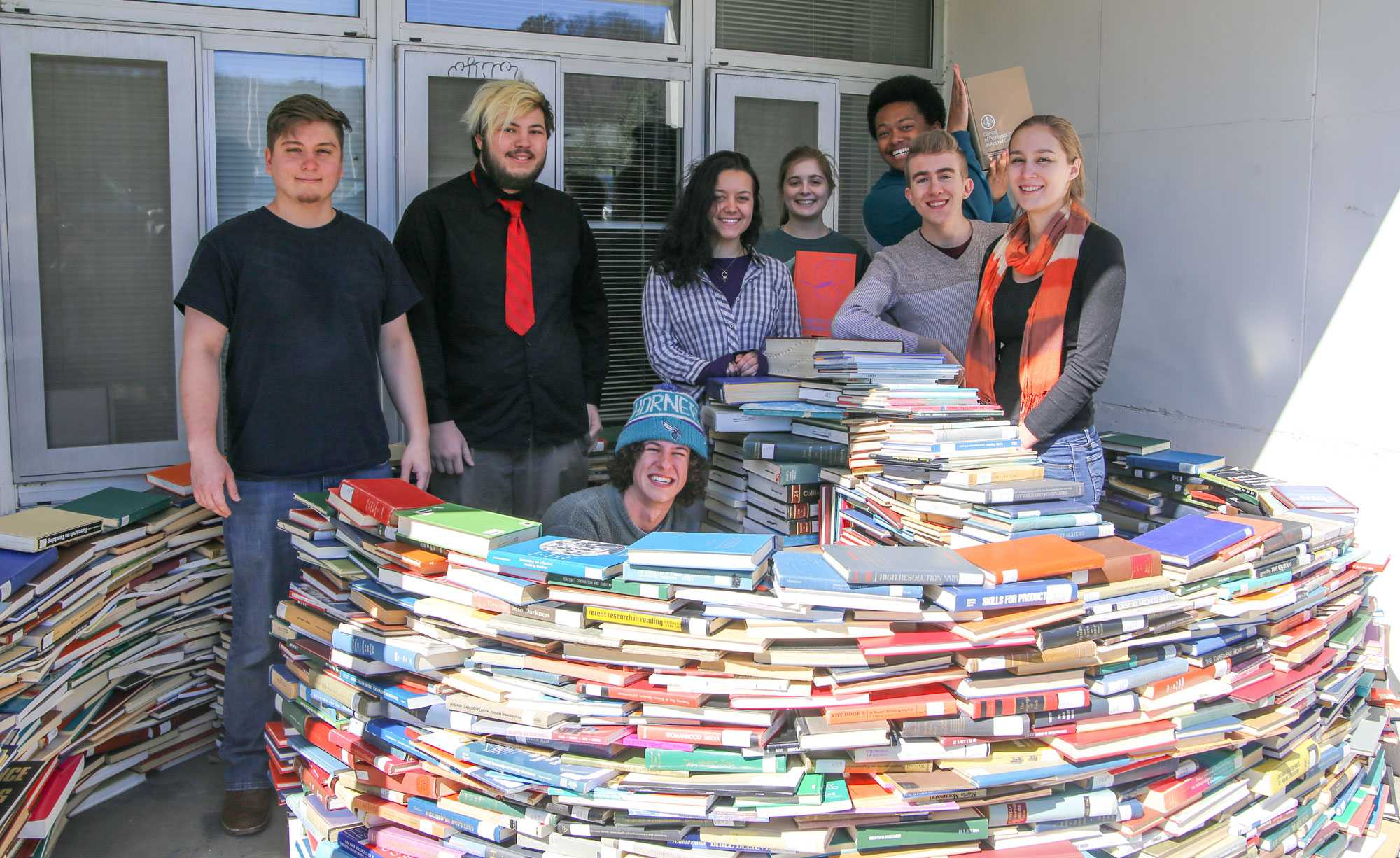 Eco-Reps pose with an igloo they made out of used books last year.