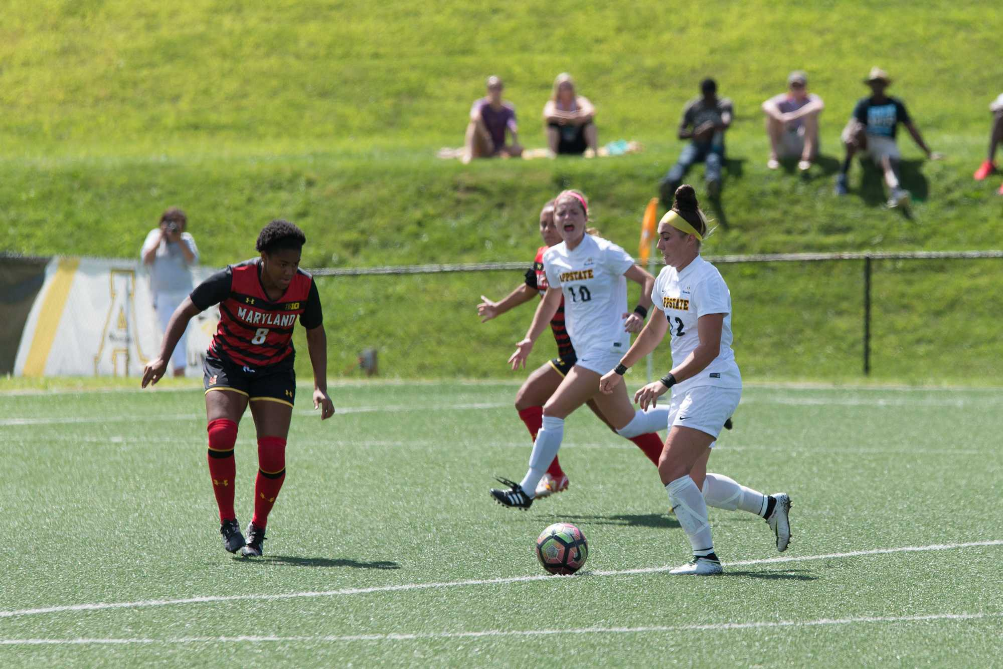 Redshirt sophomore Erin Settle goes for her successful shot against Maryland. Settle scored the first goal for the team in the second half.  Senior forward Jane Cline in the background later scored the winning second goal. Photo by Dallas Linger, Photo Editor