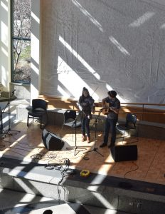 Musicians perform for judges and an audience in the Solarium during the adult fiddle competition.