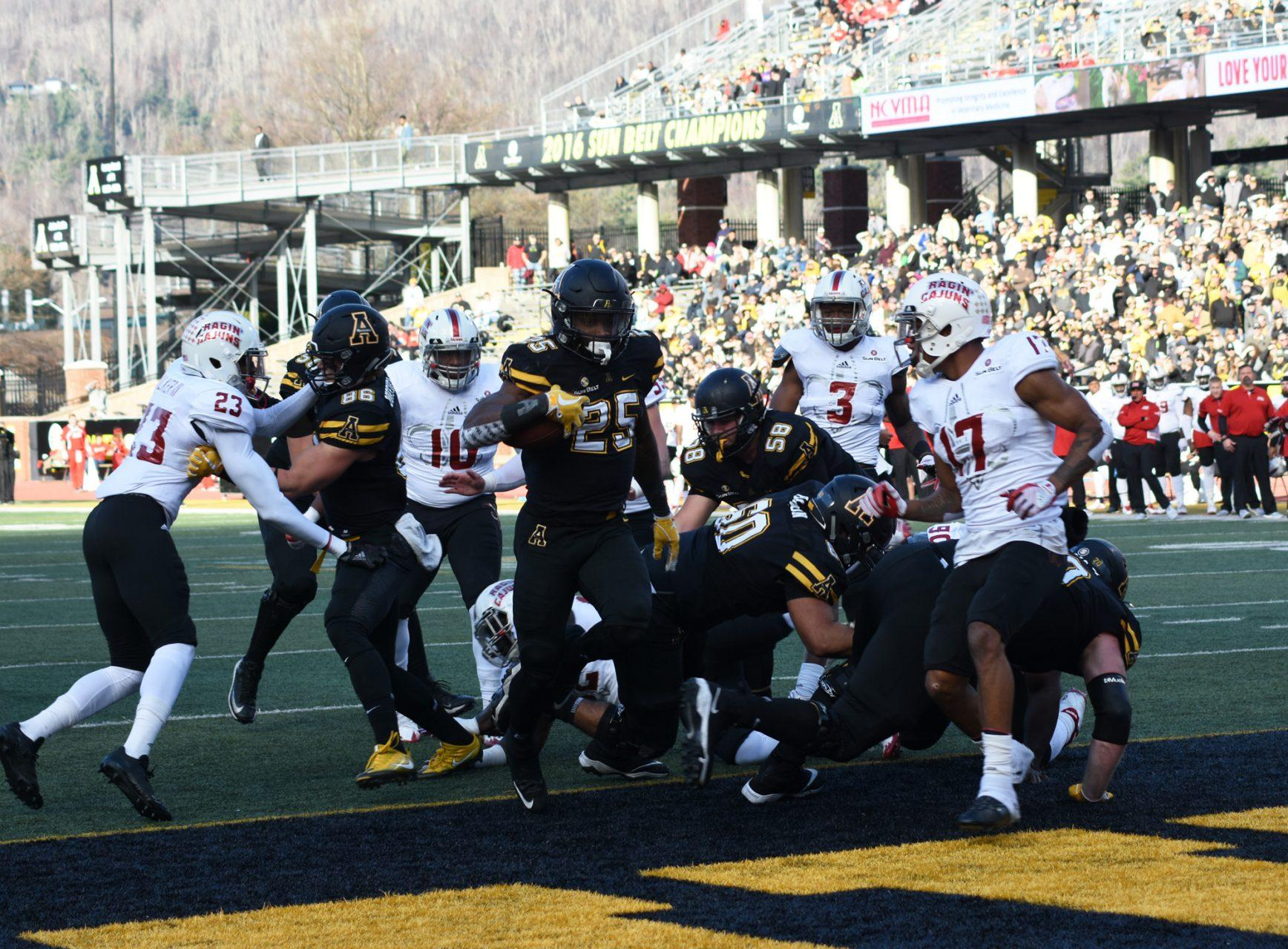 App State running back Jalin Moore scores a  touchdown against Louisiana. App State defeats Louisiana 63-14  at Kidd Brewer Stadium.