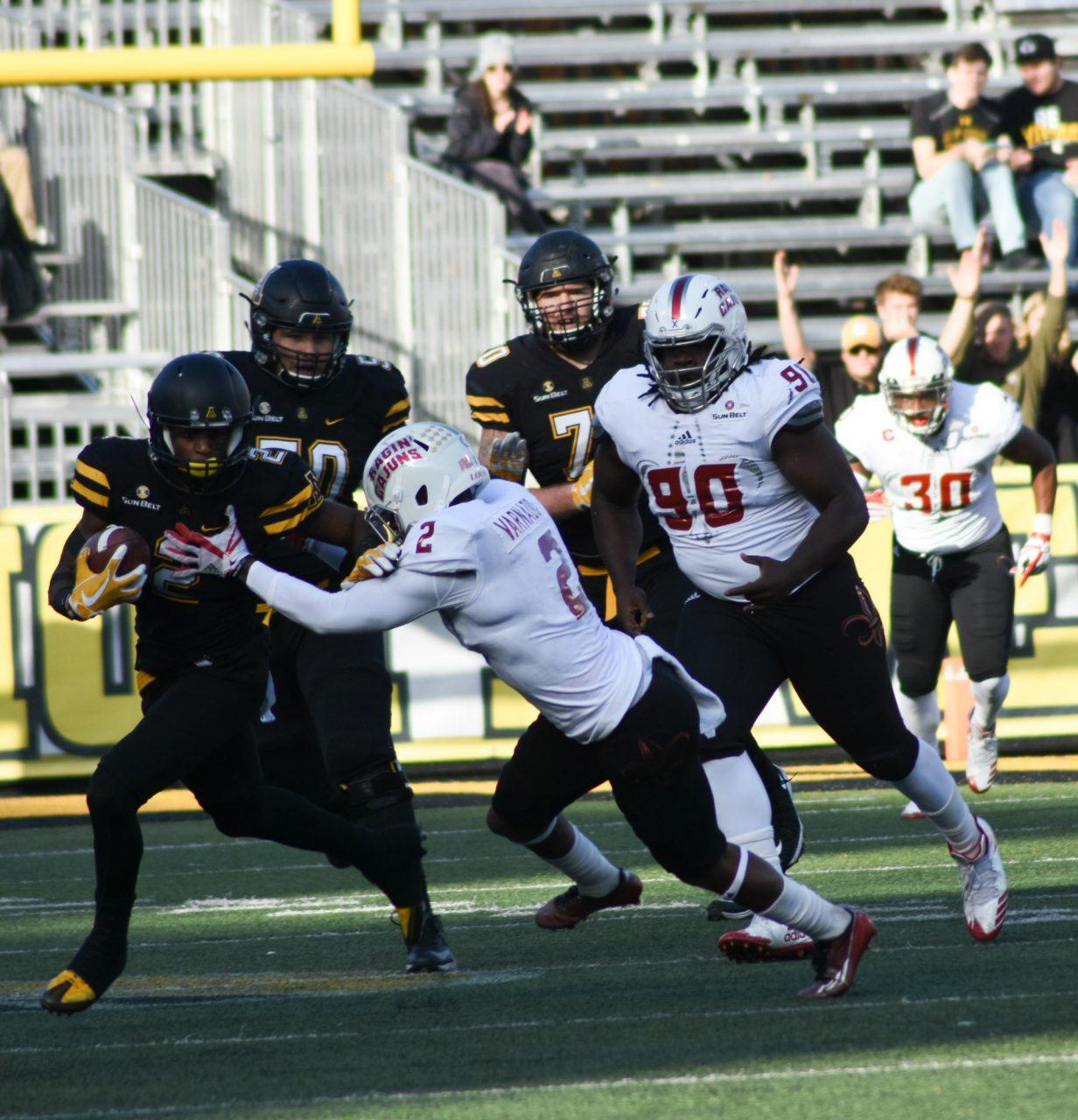 App State Wide Receiver Ike Lewis avoiding a Louisiana tackler. The Mountaineers defeat Louisiana 63-14 at Kidd Brewer Stadium.