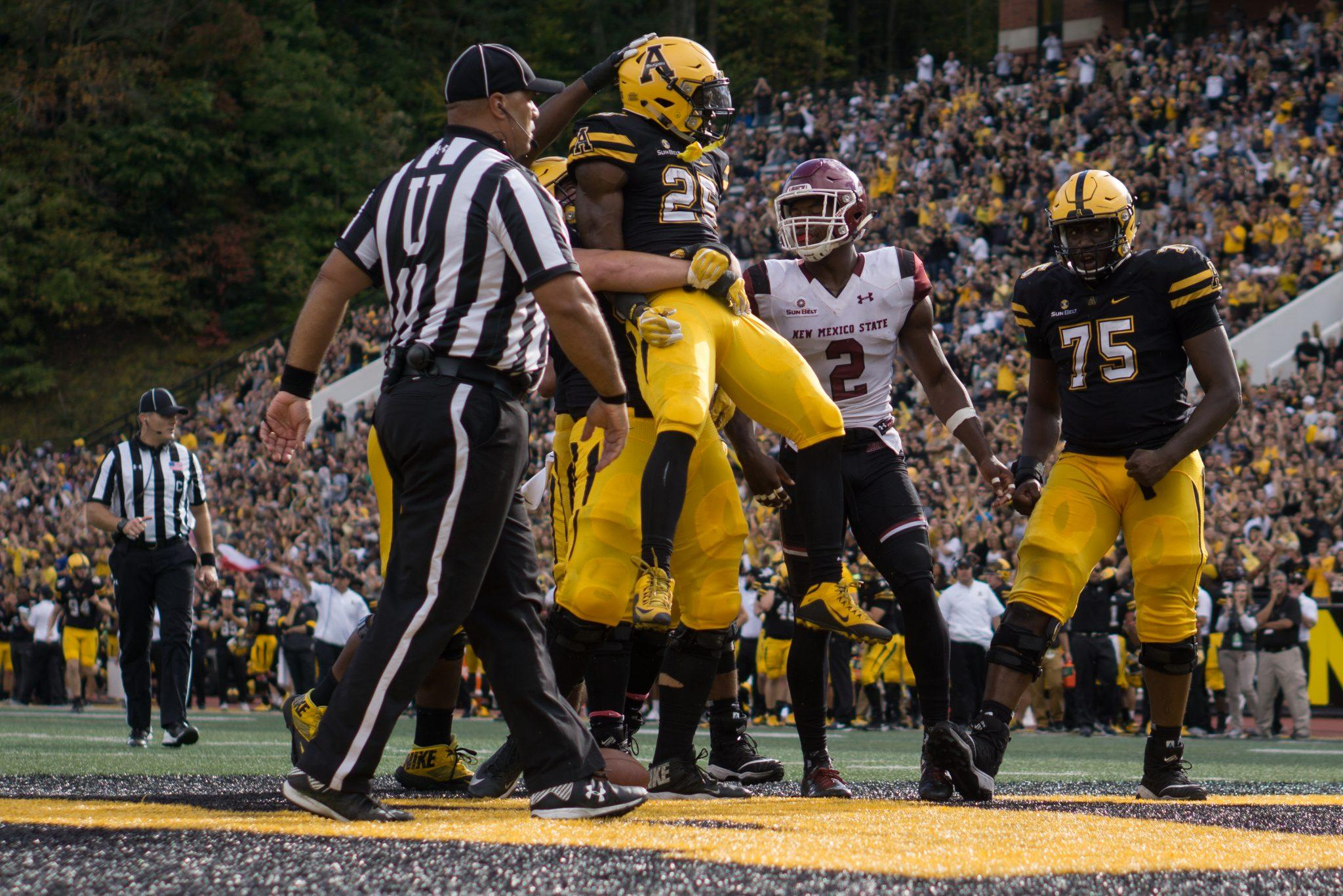 Jalin Moore celebrating with teammates after one of his two touchdowns on the day