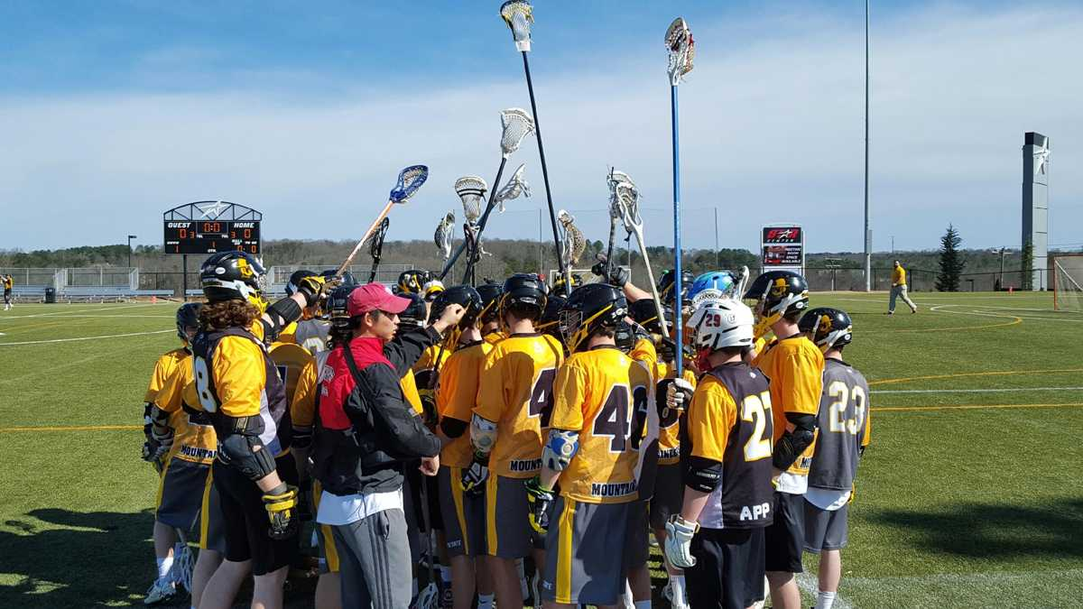 The App State club lacrosse team huddles following their 11-6 victory over Wofford on Sunday. Photo courtesy of Grant Simpkins.
