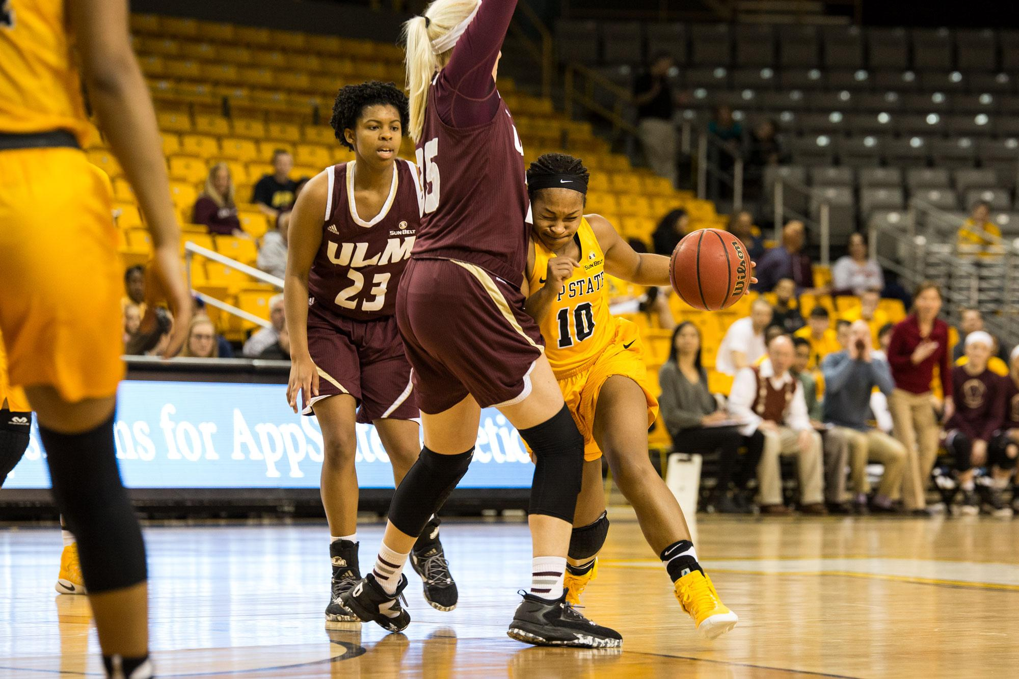 App State's senior Joi Jones drives past a Warhawks defender en route to a Mountaineer victory over ULM.