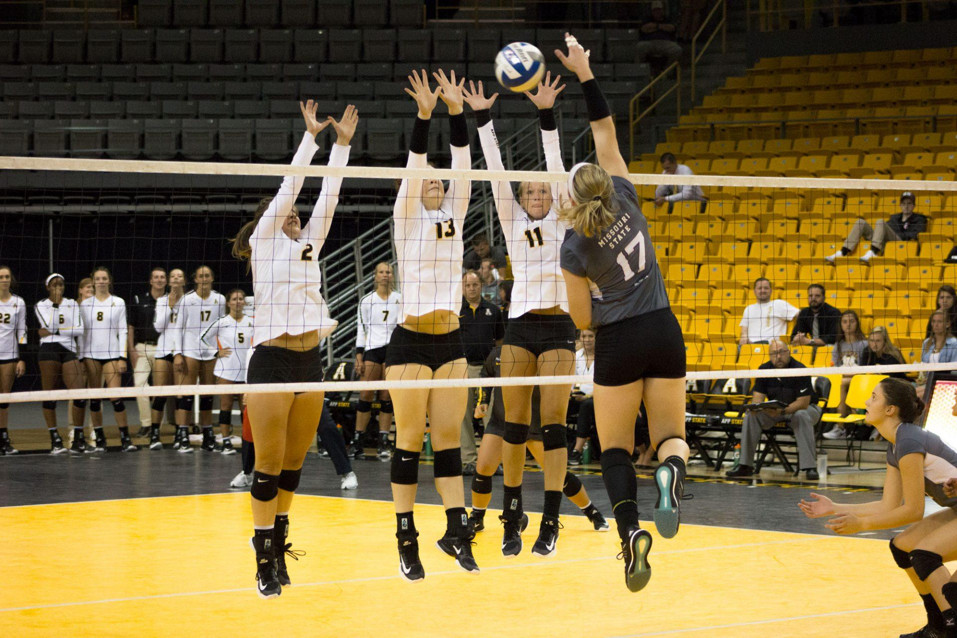 Setter Ashlyn Brown, middle blocker Kara Spicer, and outside hitter Emma Longley go up for the block during the game against Missouri State on Friday, August 25th. Longley returned to action in Sunday's victory over Troy.
