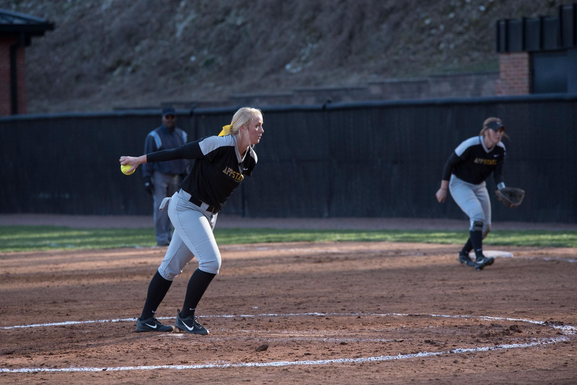 Freshman+Kenzie+Longanecker+begins+her+wind+up+to+pitch+the+ball+during+the+double+header+game+against+UNCG.
