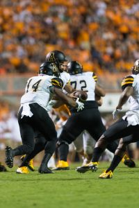 Lamb hands off the ball to running back Marcus Cox against Tennessee