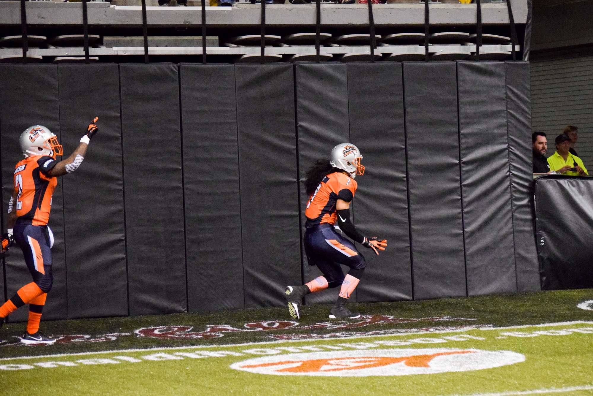 Malachi Jones scoring a touchdown during the first ever Grizzlies game. The Grizzlies are an indoor football team.