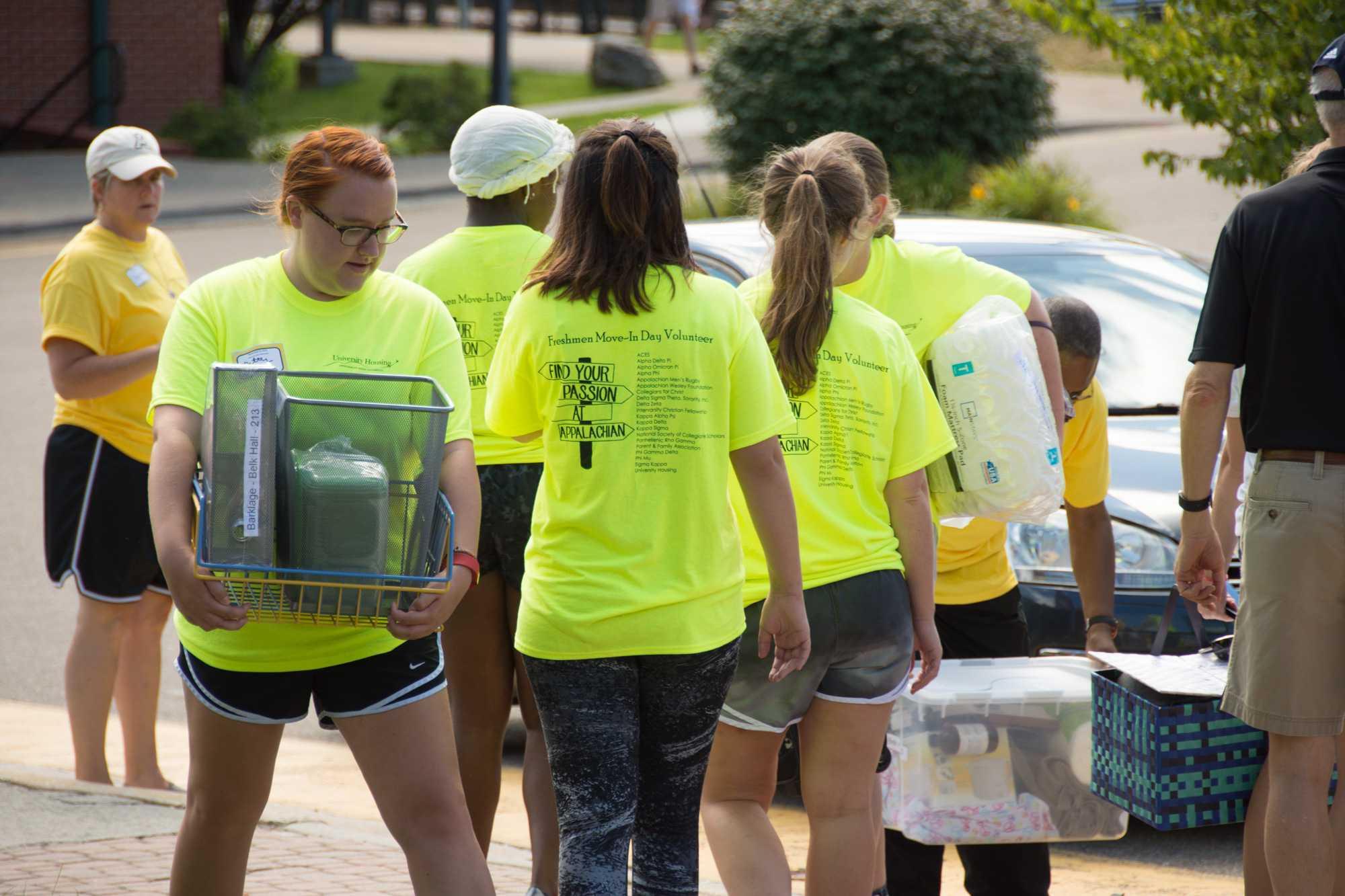 Volunteers keep move-ins moving