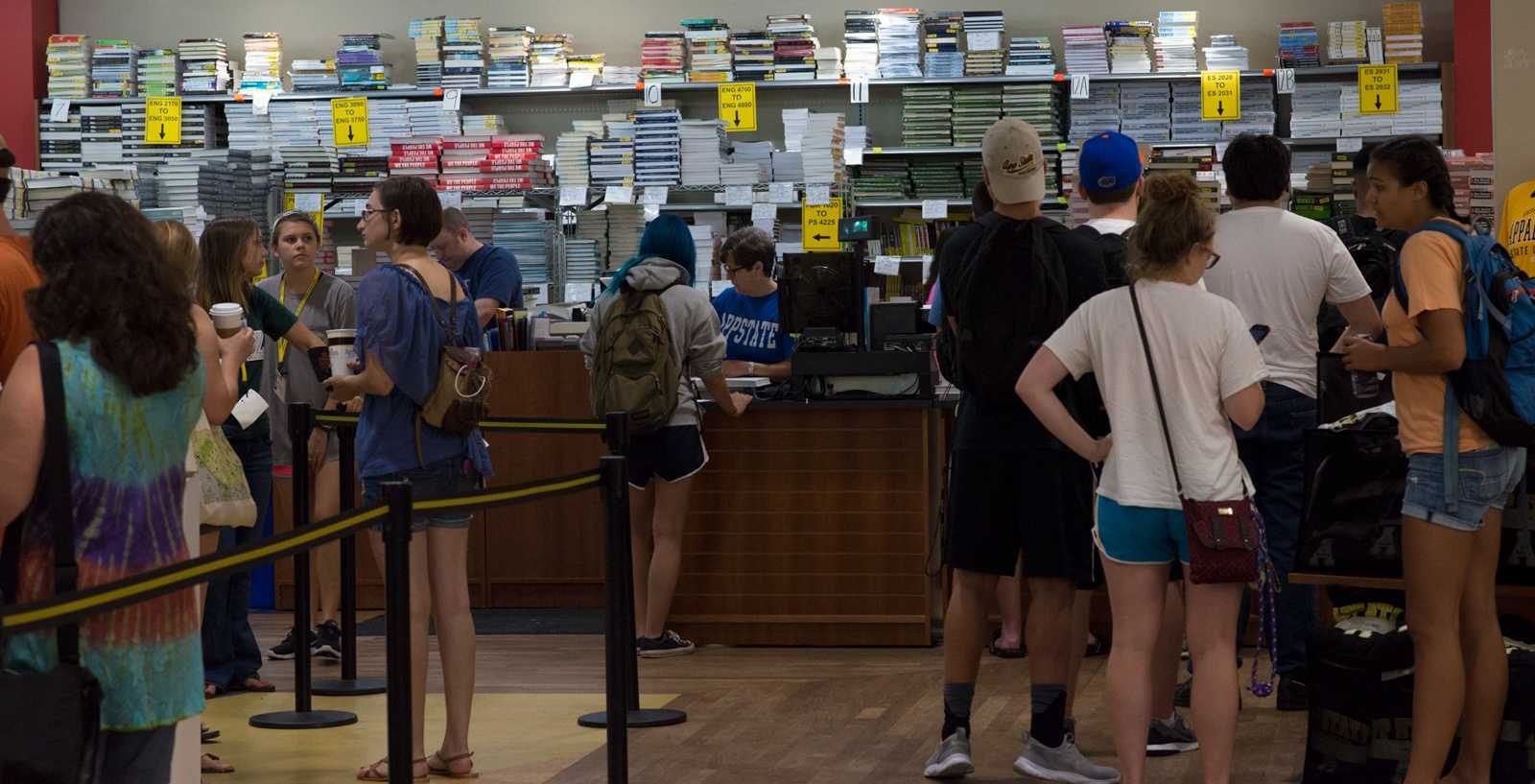 In addition to moving in to their dorms, many students picked up their textbook rentals from the bookstore. The bookstore is expected to be busy all next week as students wait in line for their textbooks. Photo by Dallas Linger, Photo Editor