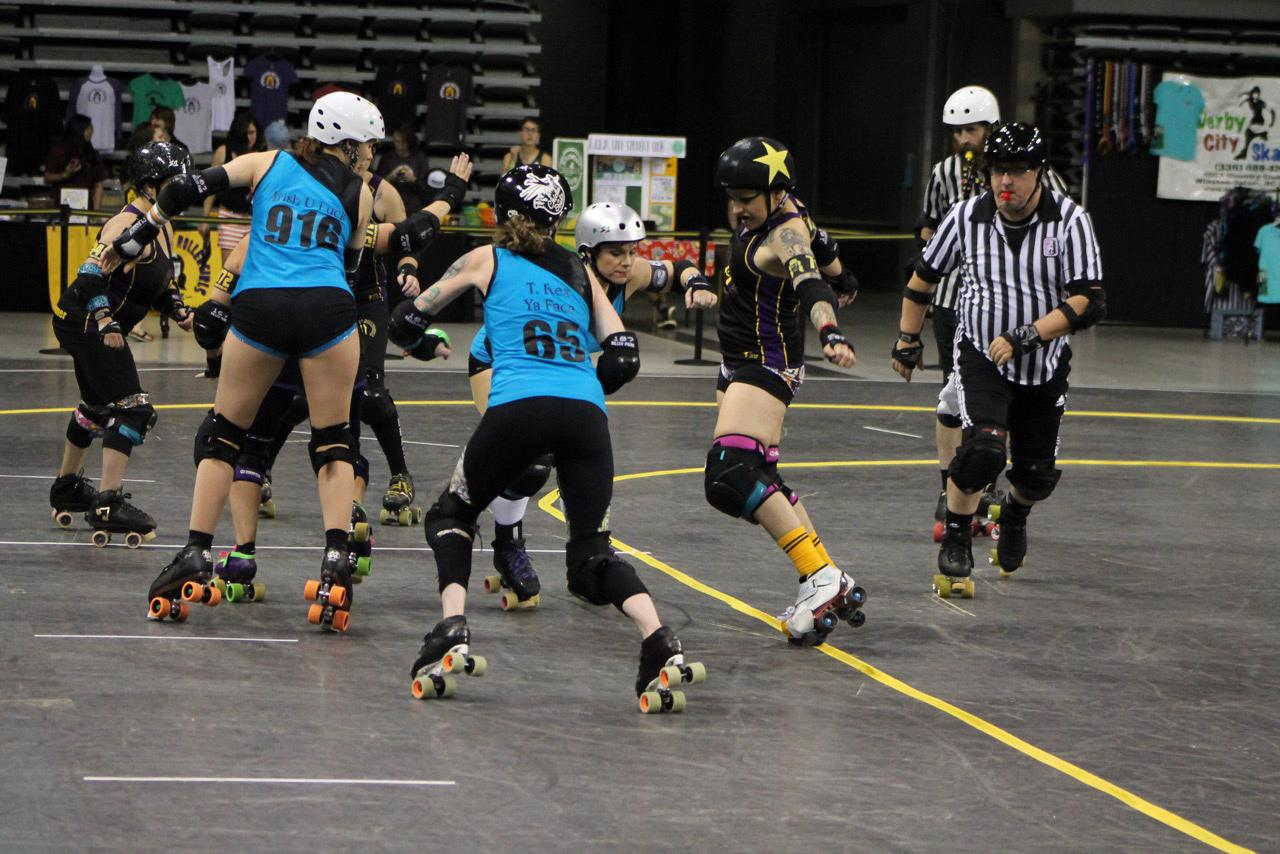Jammer P.Y.T. aka Patricia Ybanez tip-toeing the engagement zone line as Dominion Derby girls from Virginia Beach, Virginia are trying to block her. Photo courtesy of Kevin Gordon.