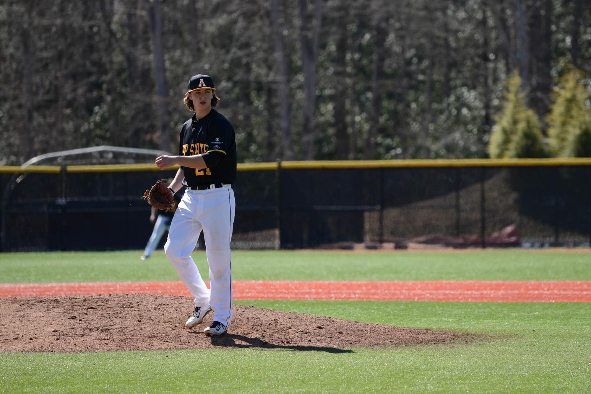 Sophomore pitcher Colin Schmid get ready to pitch the during the home game against the Quinnipiac Bobcats.