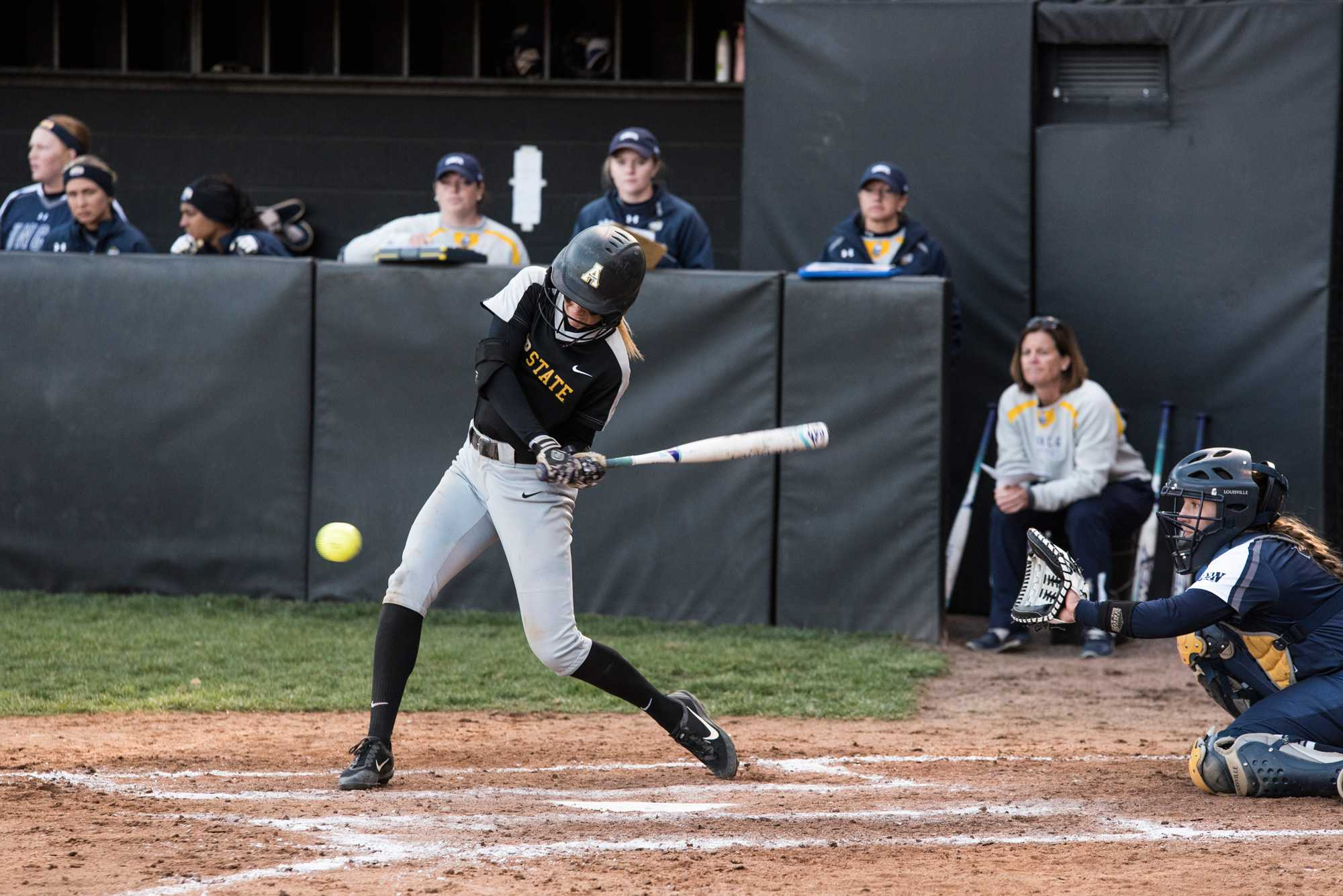 Sophomore Natalie Orcutt swings at the ball during the game against UNCG.