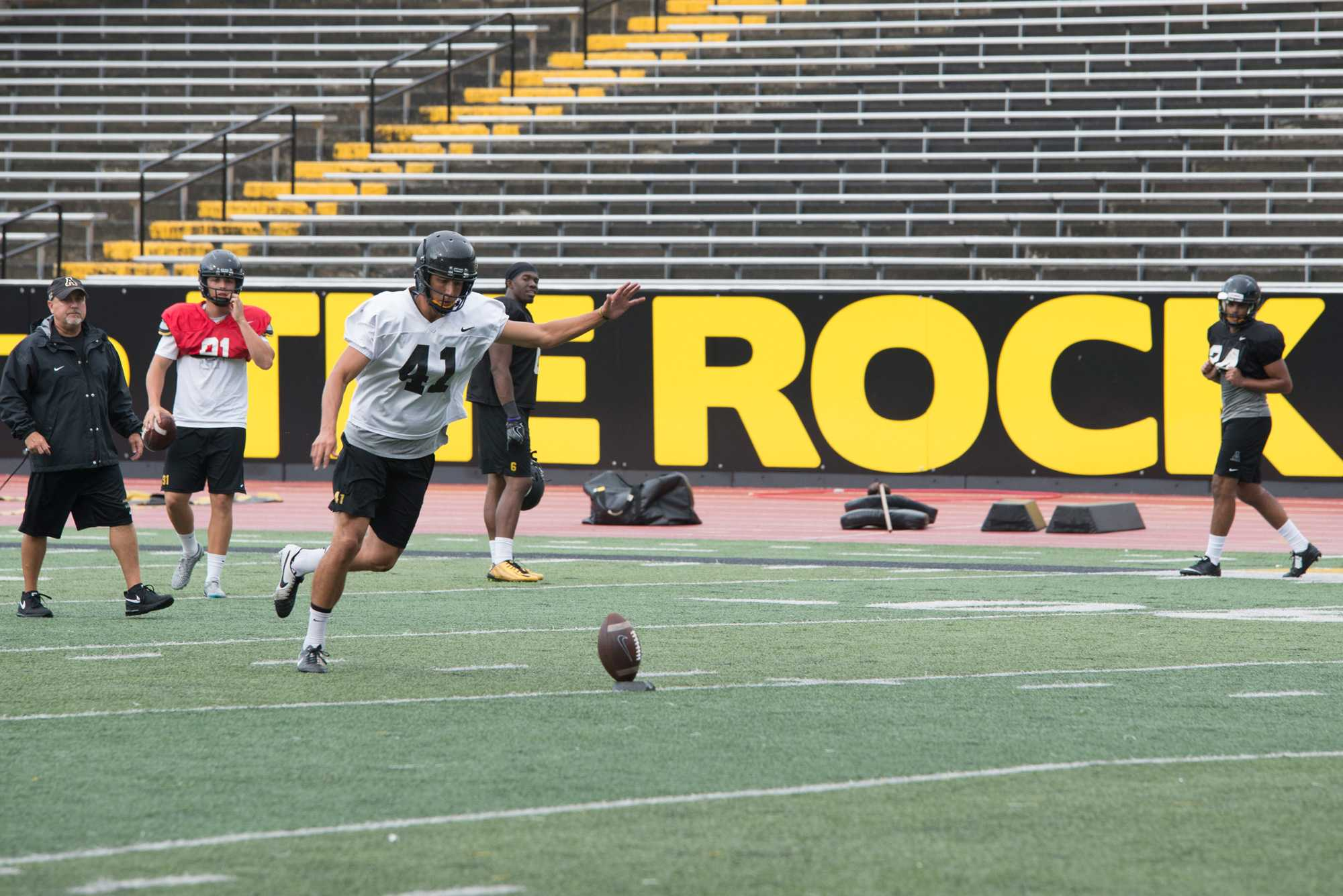 Place kicker Michael Rubino works on his kick during the football team's practice on Wednesday, August 17th, 2016.