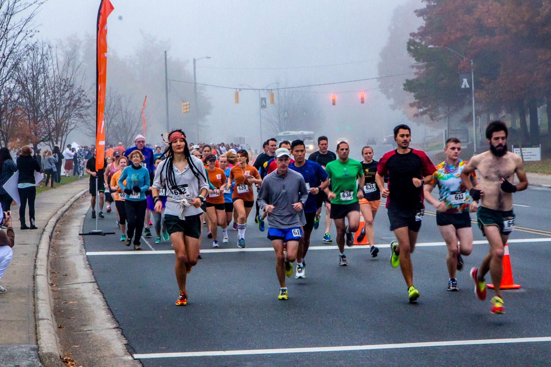 The+participants+of+the+2016+Spooky+Duke+Race+run+down+Rivers+Street+in+various+costumes.