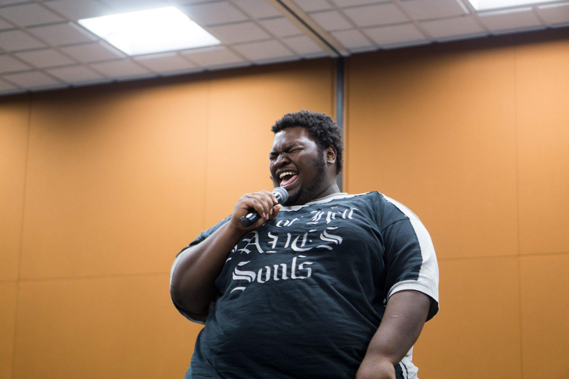 Anthony Jennings laughs with his audience during APPS' stand-up comedy competition. He performed a second, impromptu routine for a tiebreaker round with Ben Lynch.