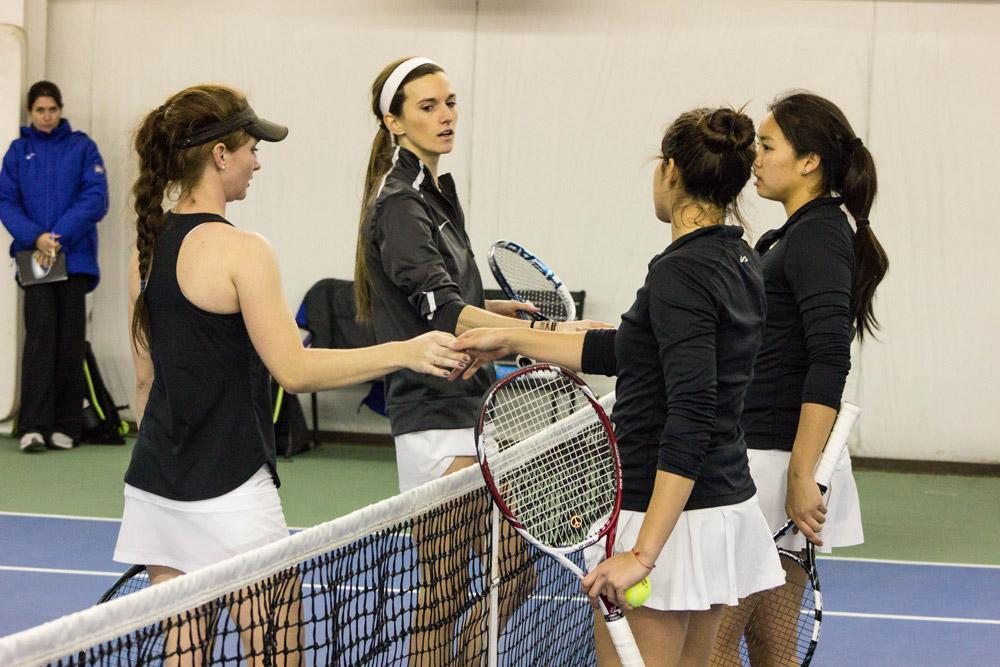 Taylor Bygrave, freshman, and her teammate Mackenzie LaSure, senior shake hands with the Emory Univeristy players after their doubles competition on Saturday, February 27th. The game resulted in App State losing 7-2 in a tie breaker match. Photo by Halle Keighton.