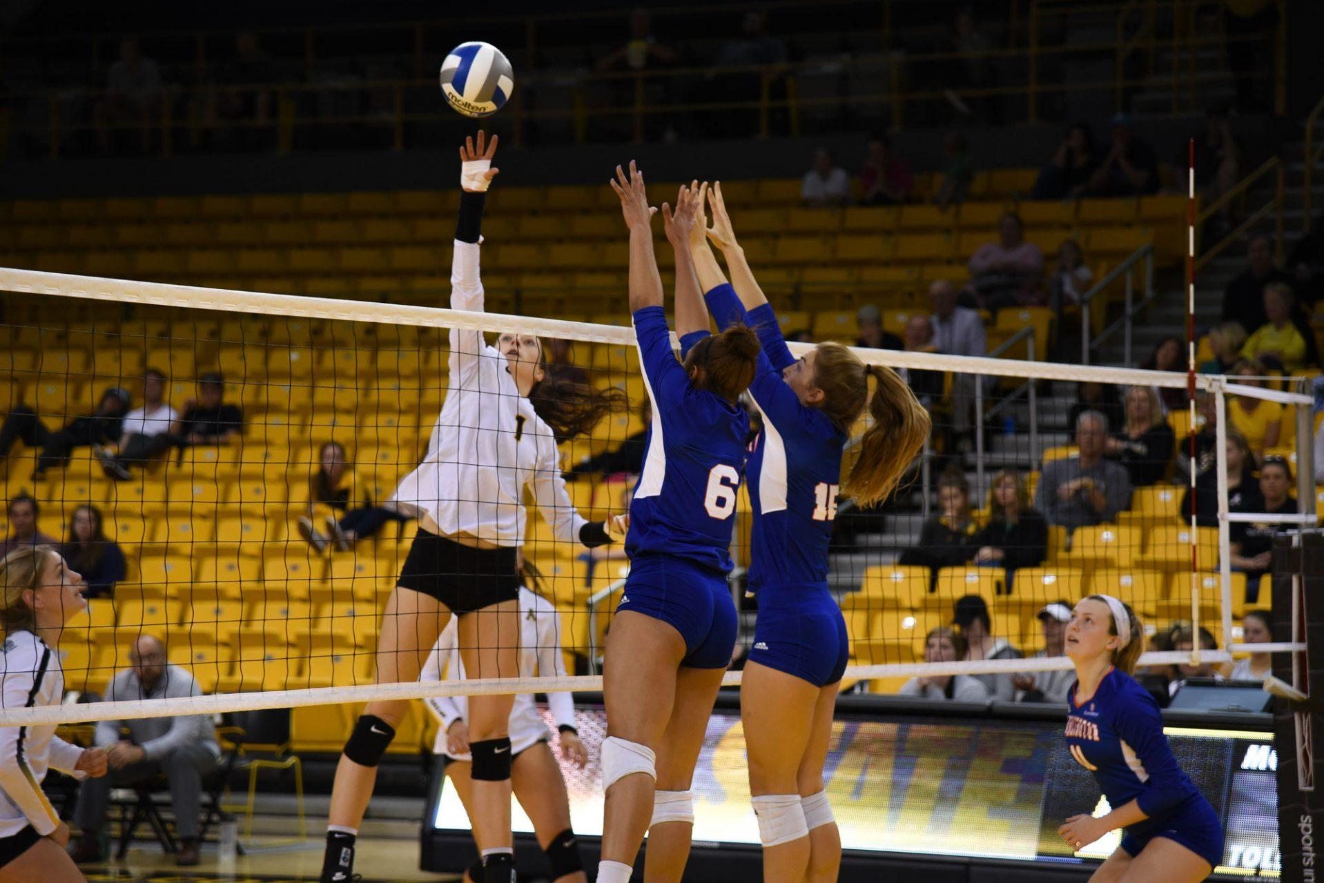Senior middle blocker Courtney Sullivan tips the ball during the game on Sunday against UT Arlington.