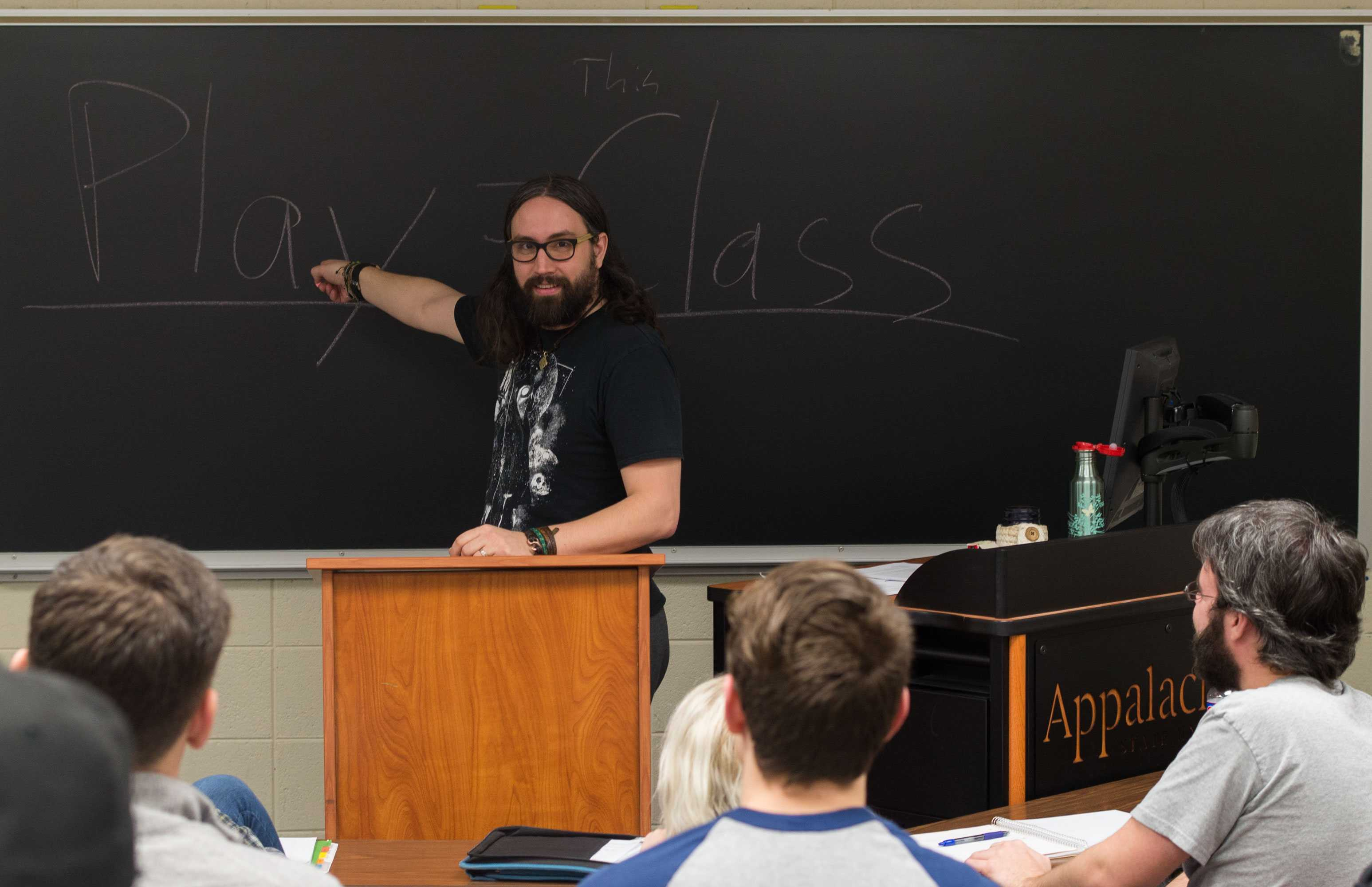 Department of Communication professor Mr. Mark Bentley lectures during his Videogame Discourse class in Walker Hall. Photo by Dallas Linger.