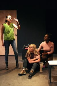 """Cast members, Kariana Galiano, Virginia Riggsbee, and Koria Johnson rehearsing a fight scene for """"Phyllis Kugler, Eat Your Heart Out"""". Opening night for the production is Thursday, February 9th."""