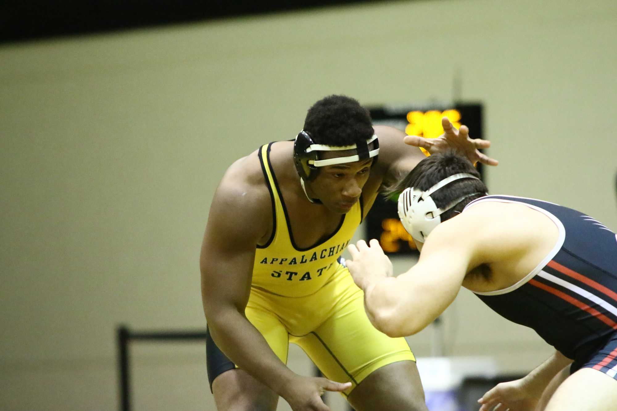 Denzel+Dejournette+prepares+to+take+down+his+opponent+during+a+match+against+SIUE.+Photo+courtesy+Appalachian+State+Athletics.
