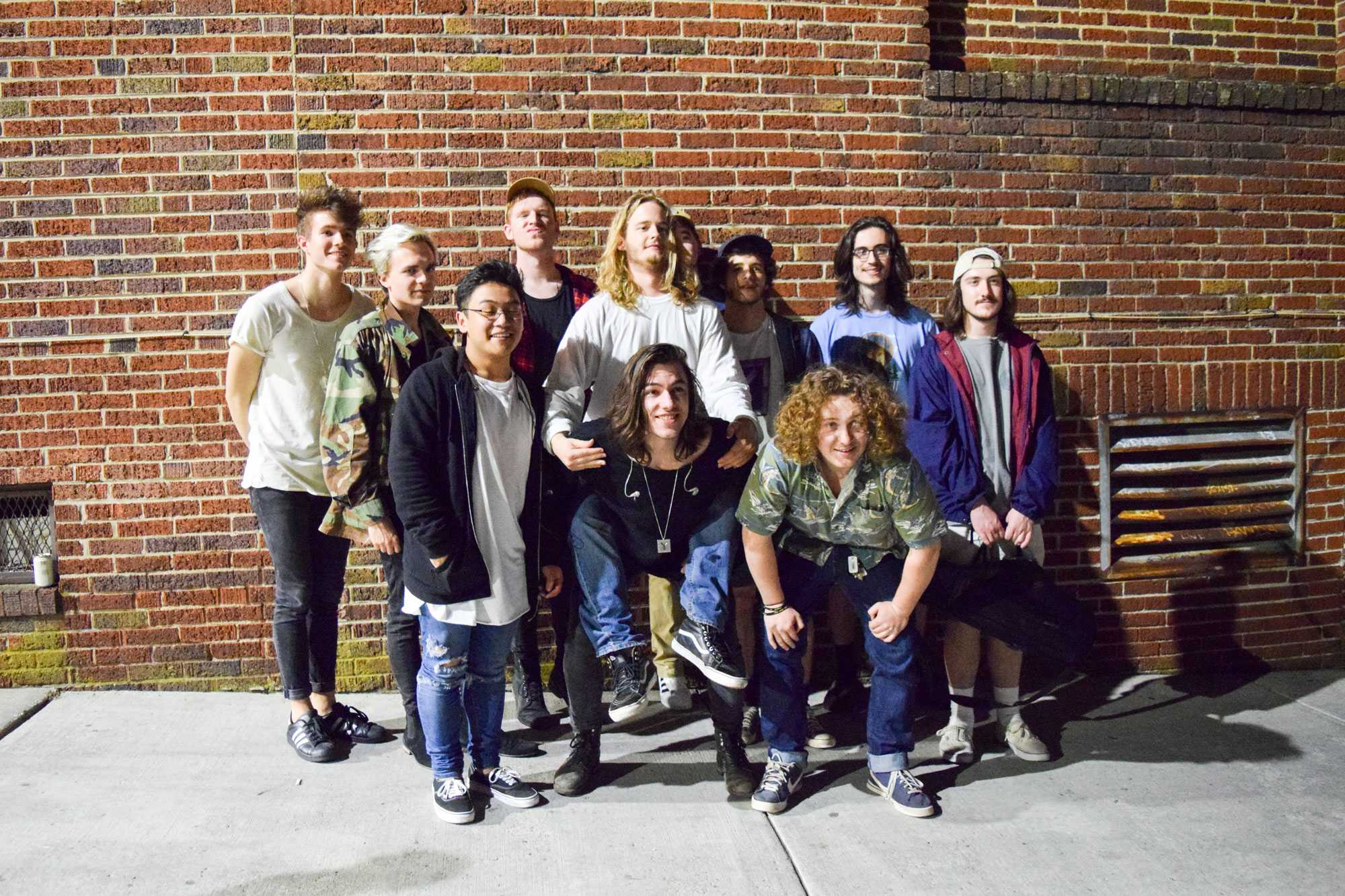 The two bands Electric Jelly Funk and Yugo pose for a group photo outside of Black Cat.