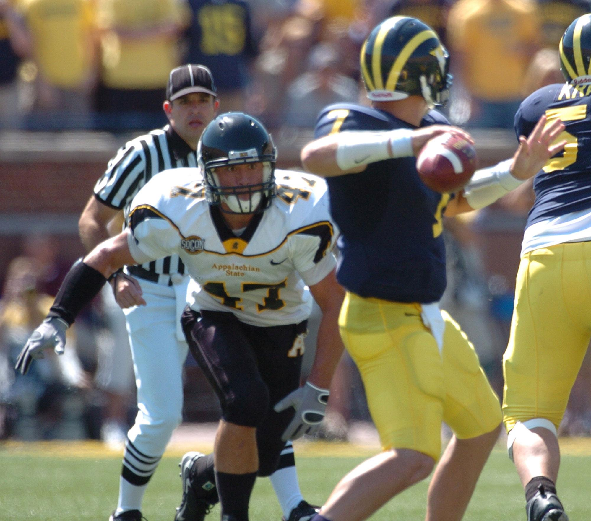 Senior+defensive+back+Corey+Lynch+pressures+Michigan+quarterback+Chad+Henne+during+the+App-Michigan+game+on+September+1%2C+2007.+%0APhoto+courtesy%3A+App+State+athletics+