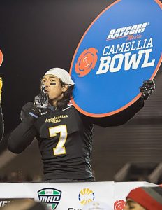 Former receiver Malachi Jones silences the crowd as he celebrates their 2015 Camellia Bowl victory. Jones is now a player for the High Country Grizzlies.