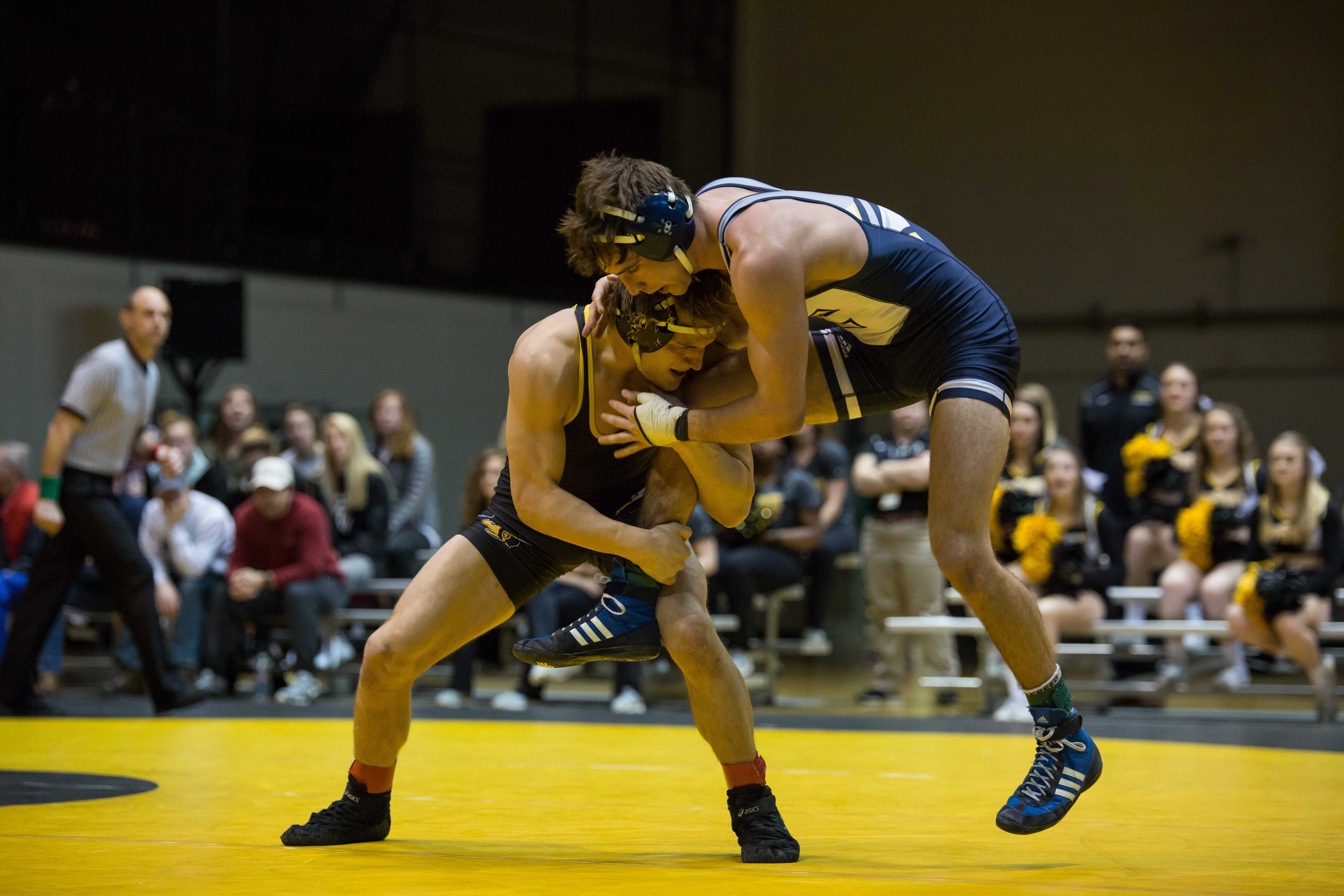 The Mountaineer's Matt Zivistoski attempts to take down Chattanooga's Roman Boylen. Following a 16-16 tie, the Mountaineers stayed undefeated in the SoCon with a 55-54 tiebreaker over the Mocs.