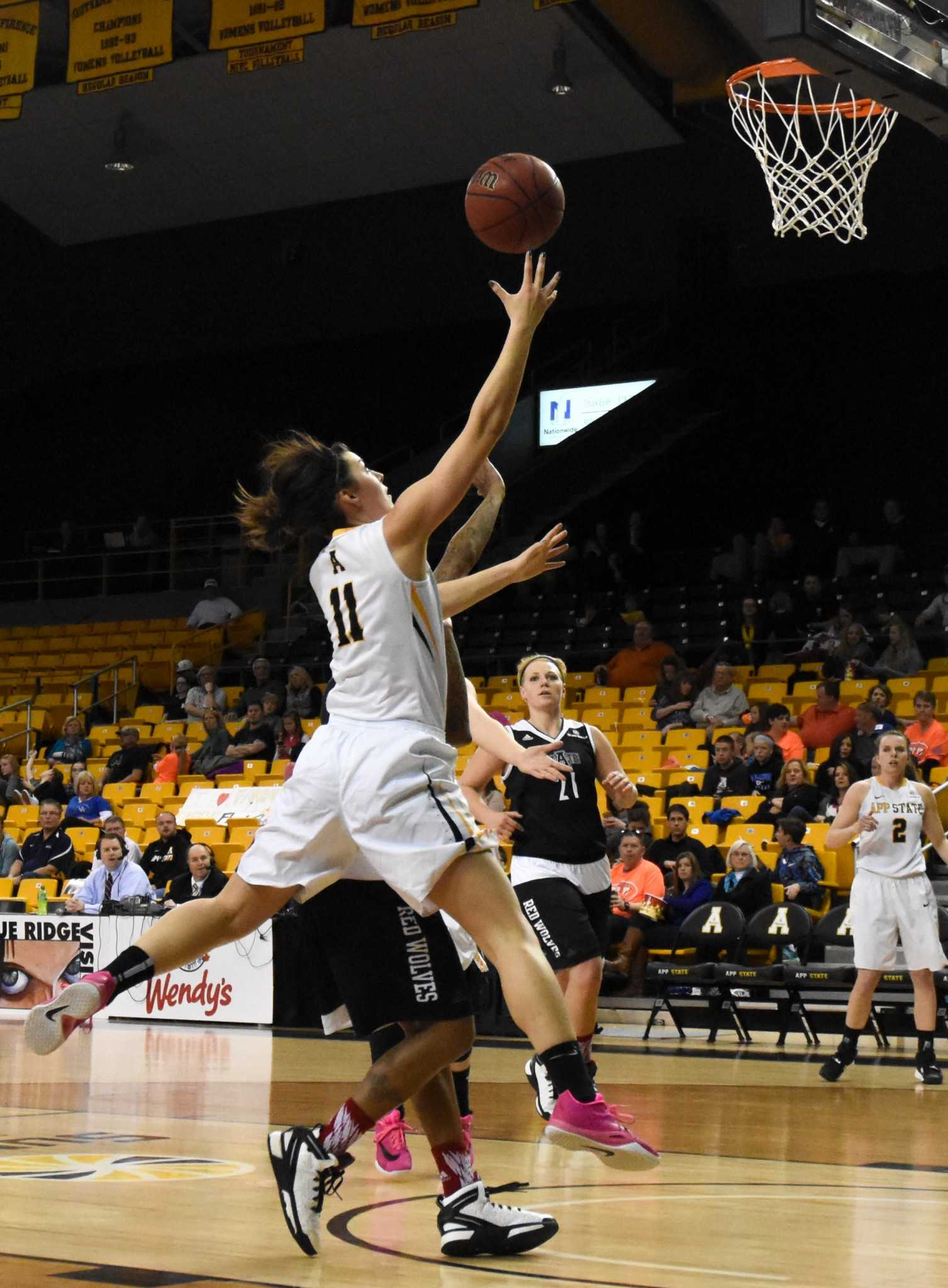 Freshman+Guard+Kaila+Craven+goes+up+for+a+contested+layup+against+Arkansas+State+University+on+Saturday+afternoon%2C+March+5.+74-83+%28L%29.+Photo+by+Dallas+Linger%2C+Photo+Editor.