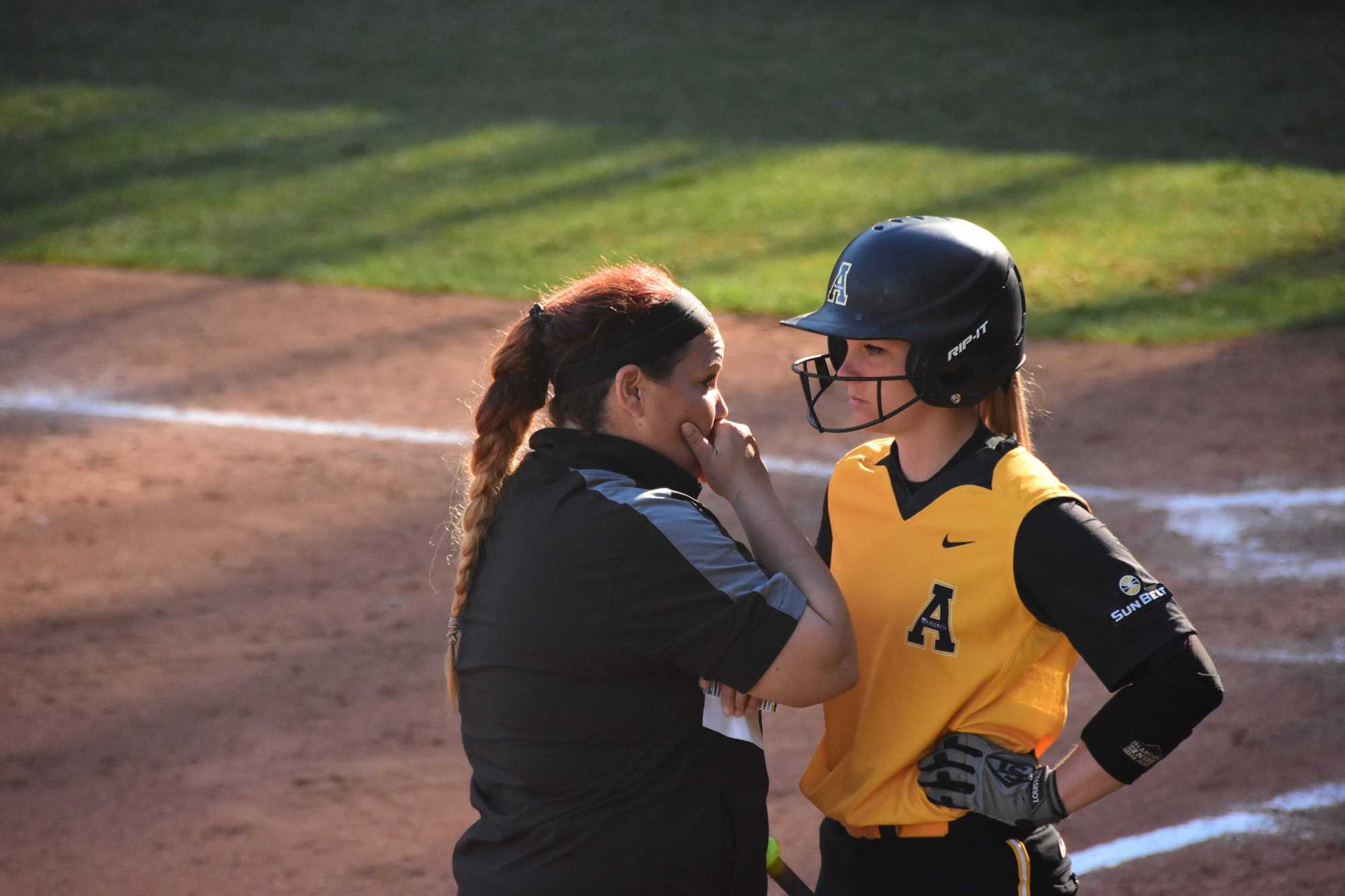 Sophomore third baseman Tiffany Taynor and head coach Janice Savage conference before Taynor's at bat against Morehead State on Tuesday, March 22. 0-7 (L). Photo by Lee Sanderlin.