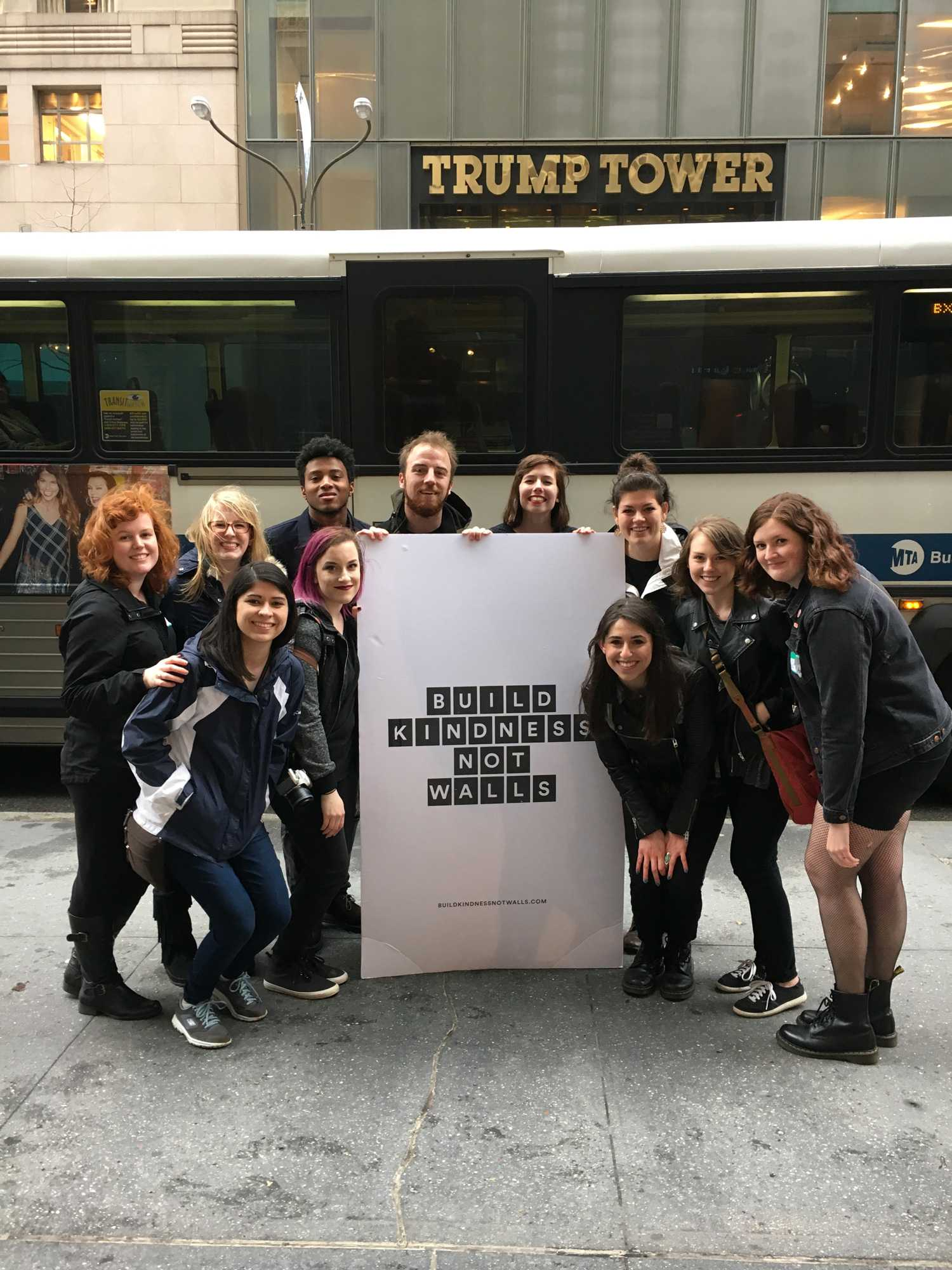 """Appalachian State University students hold up a sign that reads """"build kindness not walls,"""" in front of Trump Tower in New York City. Photo courtesy Rachel Bowles."""