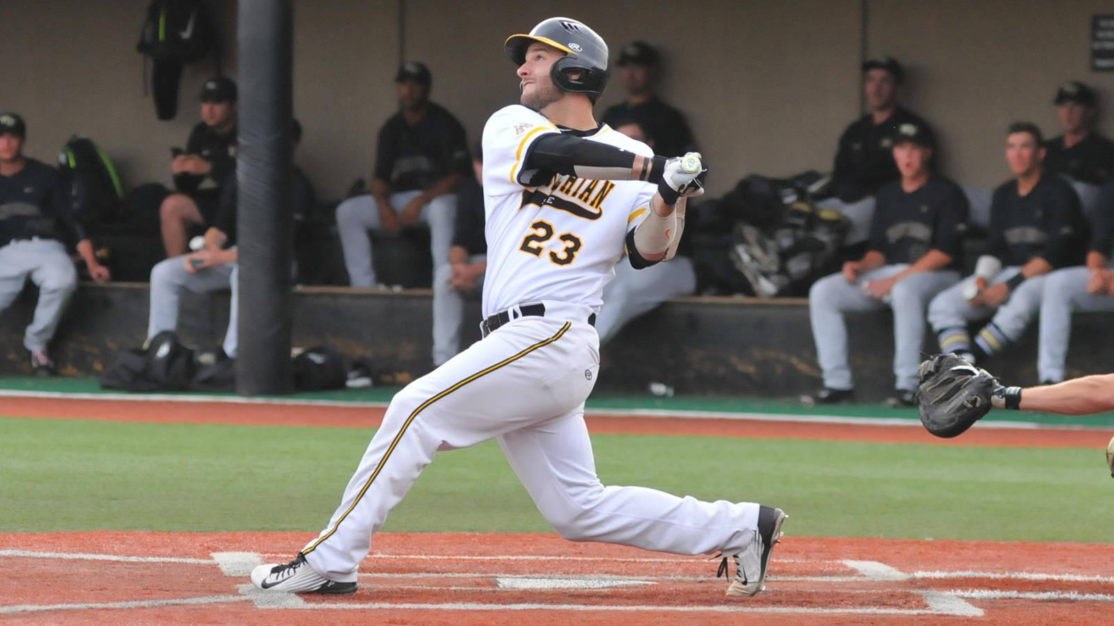 Senior right-handed pitcher and infielder Caleb McCann follows through his swing. Courtesy of DC Mayo; App State athletics