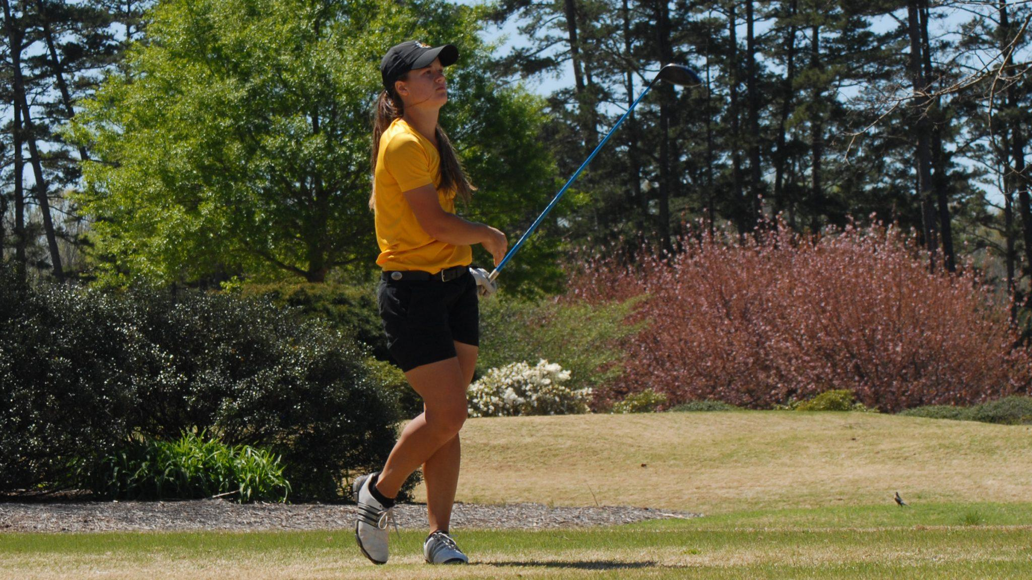 Senior Madalyn Davis reacts to her drive at the Mimosa Hills Intercollegiate.