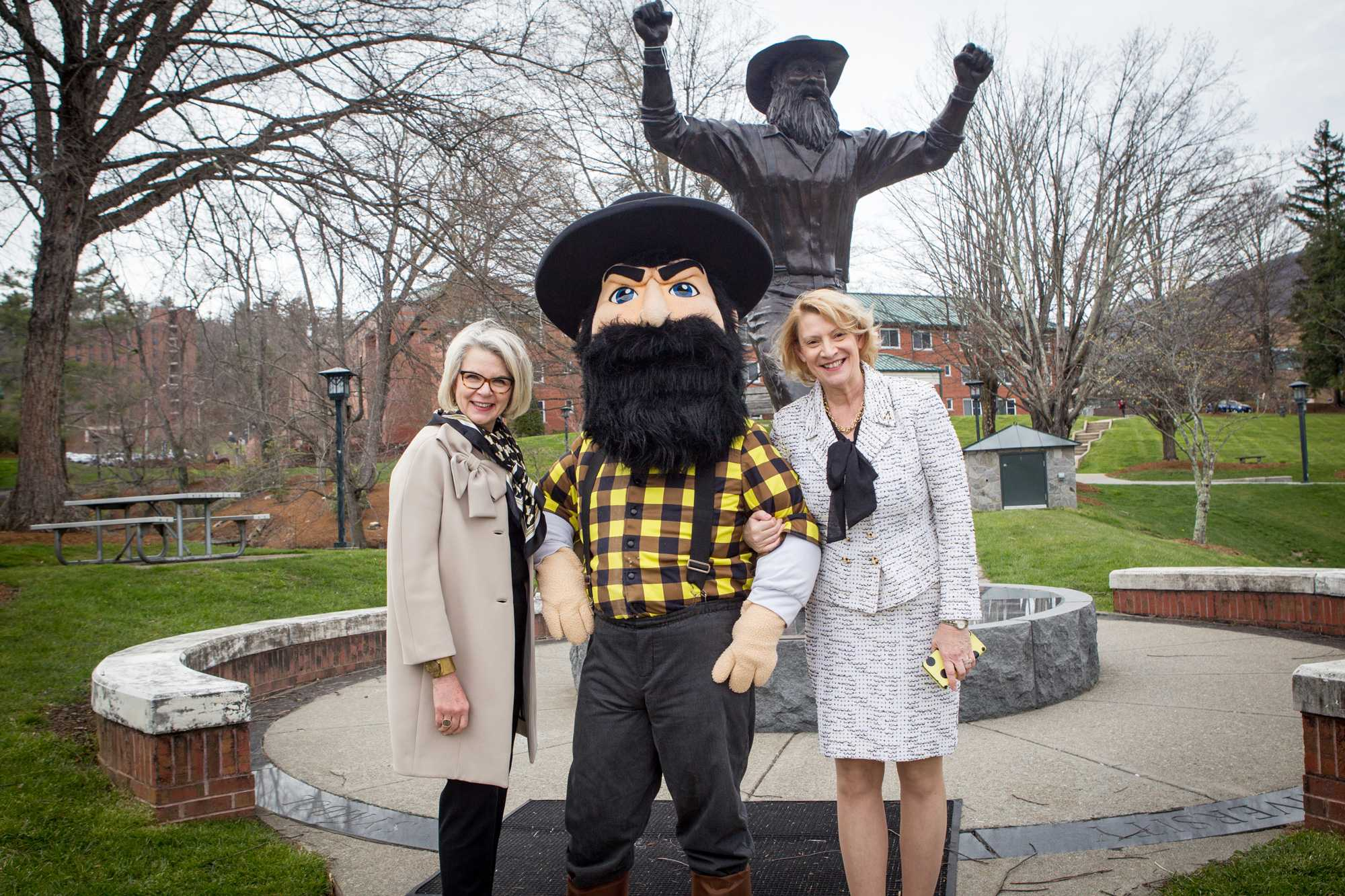 University of North Carolina System President Margaret Spellings and Chancellor Everts stand in front of the Yosef statue with Yosef.