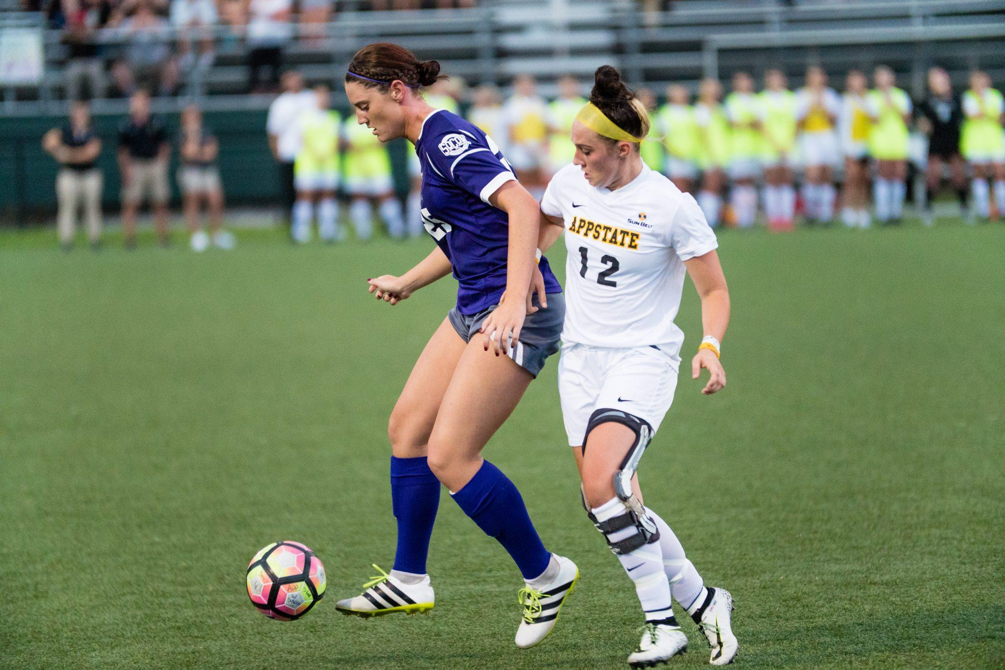 Junior Erin Settle battles for the ball in Thursday's exhibition game. Photo by: Maleek Loyd