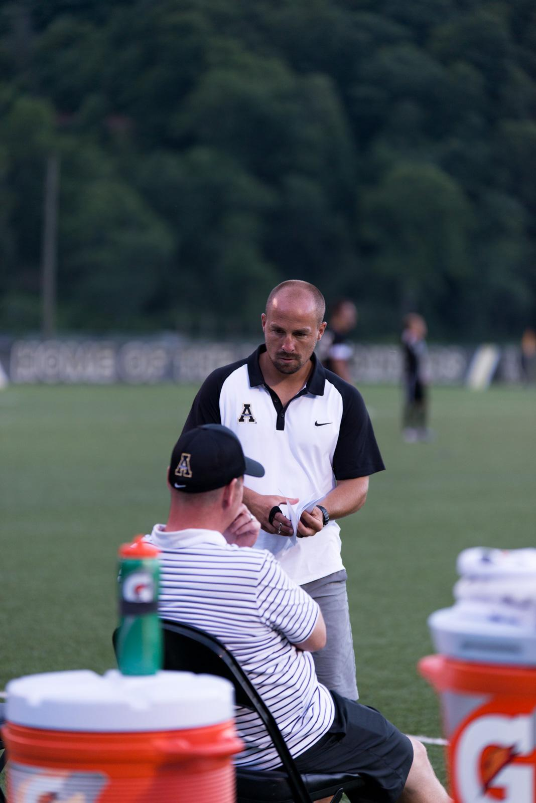 Assistant Coach Jeff Bilyk and Head Coach Jason OKeefe strategizing during the exhibition on Friday at Ted Mackorell Soccer Complex.