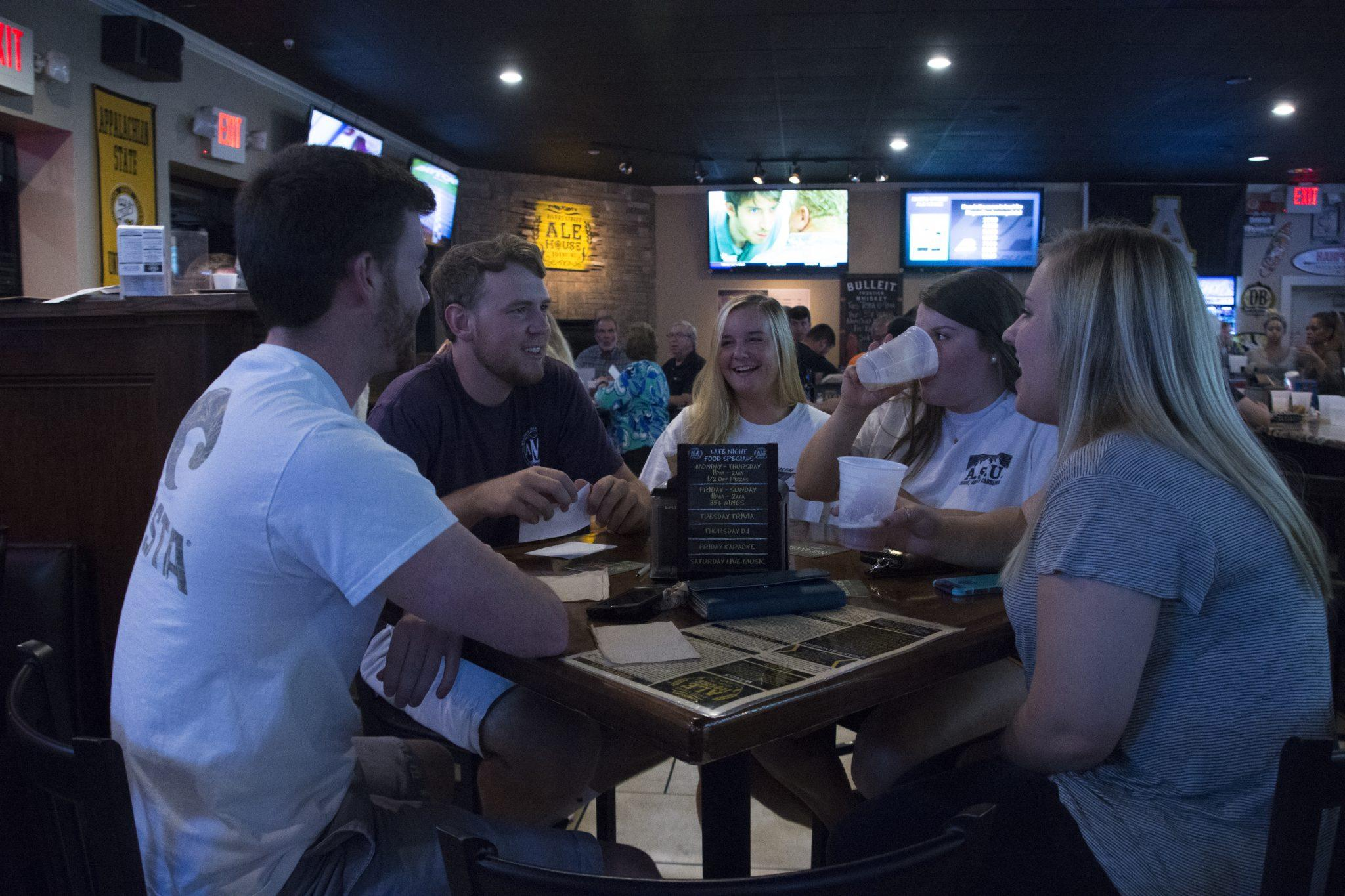 Chris Deal, Drew McCarty, Mackenzie Reid, Hannah Seipel and Sarah Winter form a group for trivia night at Rivers Street Ale House.
