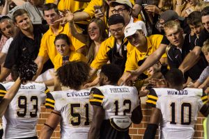 Defensive end Caleb Fuller and cornerbacks Brandon Pinckney and AJ Howard high five the fans in Knoxville. Photo by Halle Keighton