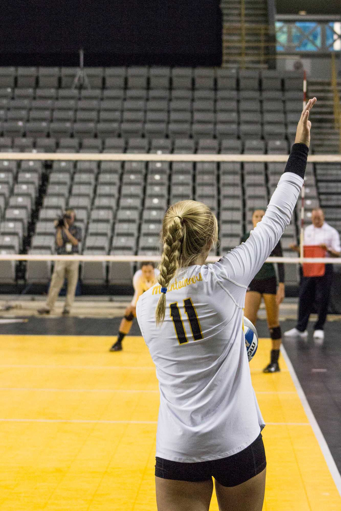Freshman+outside+hitter+Emma+Longley+prepares+to+serve+the+ball+in+a+game+against+Ohio+on+Sept.+3.+App+lost+3-0.