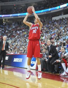Former Davidson Basketball player Stephen Curry goes up for a shot with Fox on the sideline as an assistant coach.