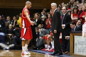 Jim Fox, standing on right, coached at Davidson for 13 years including an elite NCAA tournament run in 2008 with current NBA MVP Stephen Curry, left, and Davidson Coach Bob McKillop, middle.