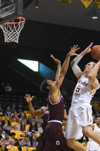 Junior foward, Griffin Kinney, shoots the ball during the game against Little Rock last season. He is one of the first players that Jim Fox recruited at Appalachian State.