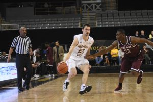 Junior guard, Jake Babic, dribbles the ball down the court during the game against Little Rock last season. He is one of the first players that Jim Fox recruited at Appalachian State.