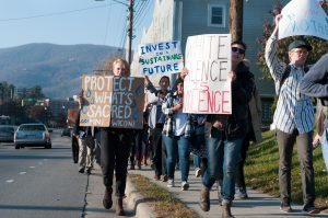 Pipeline protestors make thier way down Blowing Rock Road to the Wells Fargo Bank.