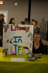Sophomore, Kasie McCann at the Celebration of Student Writing event. She wrote about taking certain parts of someones life and interweaving them like the game of life, we are all connected. She took different parts of peoples life that they thought were important to them and interwove them.
