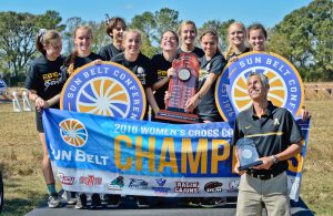 Women's Cross Country team celebrates winning their first Sun Belt Conference Championship.