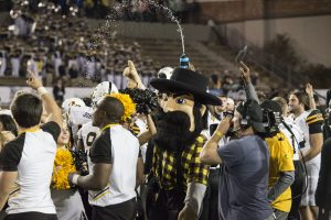Fans celebrate after the bowl win. Photo credit: Halle Keighton