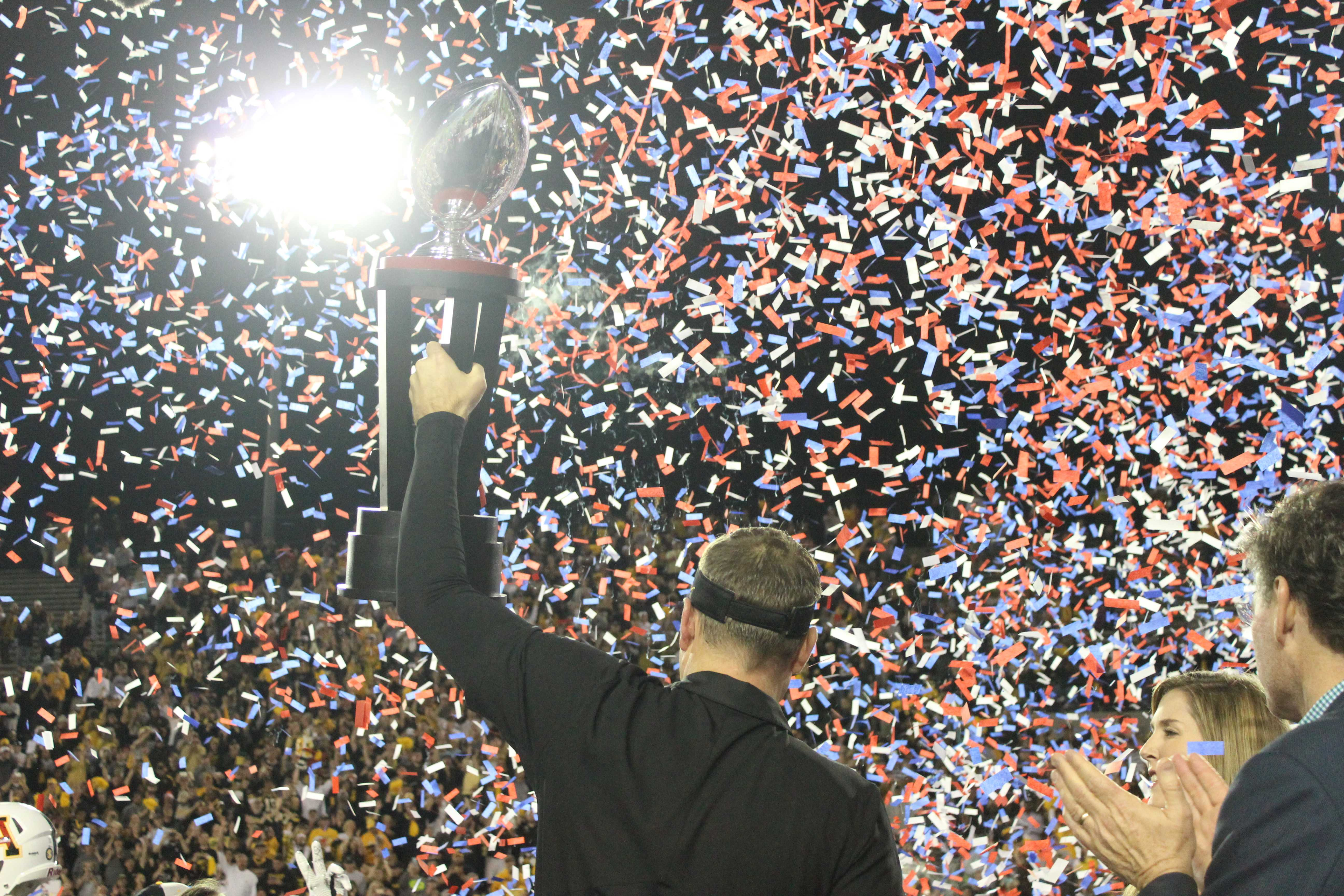 Scott Satterfield hoists the Camellia Bowl trophy for the second consecutive season.