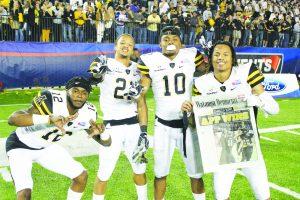 Junior, Brandon Pinckney, freshman, Clifton Duck, junior, A.J. Howard, and senior, Mondo Williams, all defensive backs, celebrate the win of the Camillia Bowl against Toledo in Montgomery, Alabama.